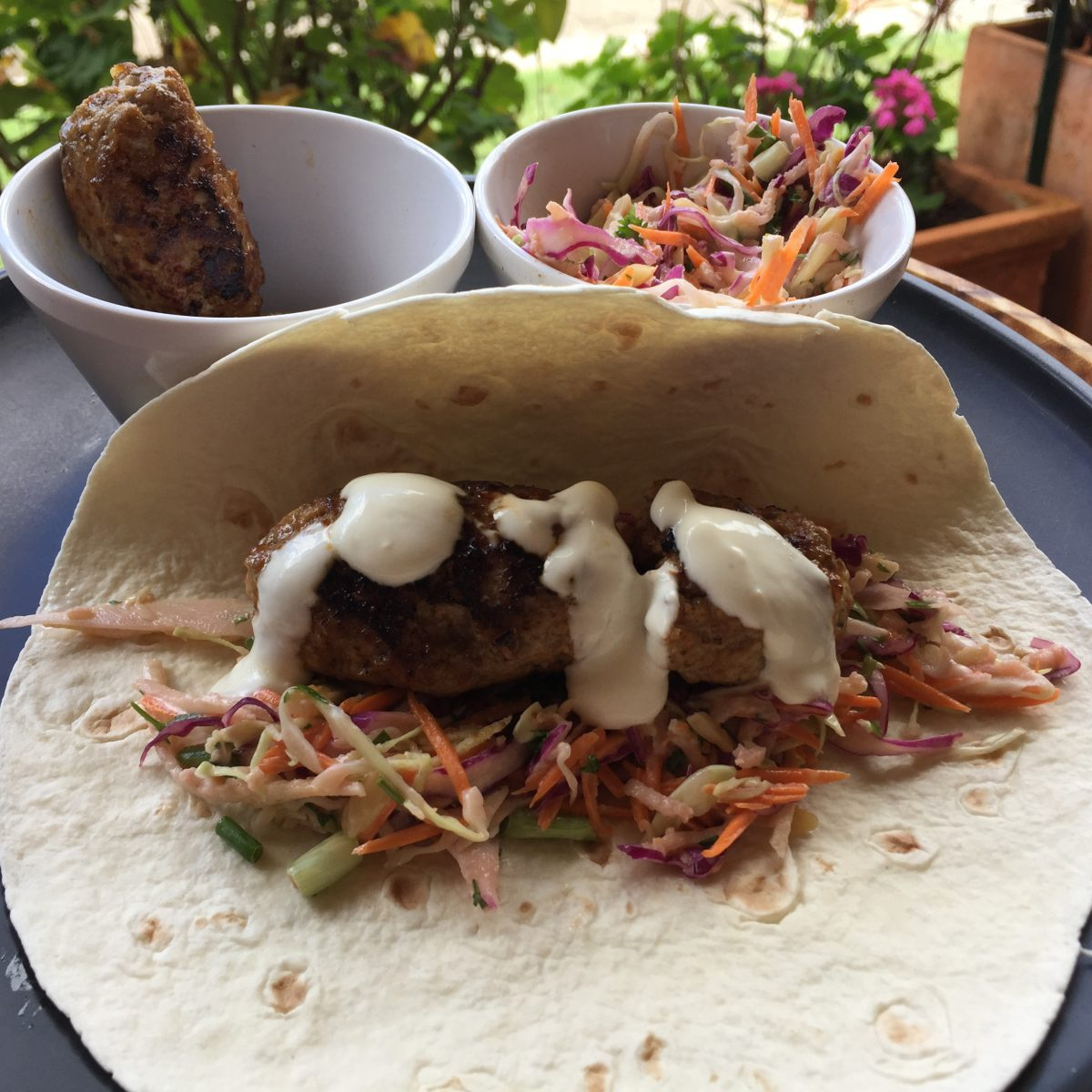 A tortilla wrap filled with a delicious rainbow apple slaw and a tasty pork kofta drizzled with aioli by cookingmealsforone.com