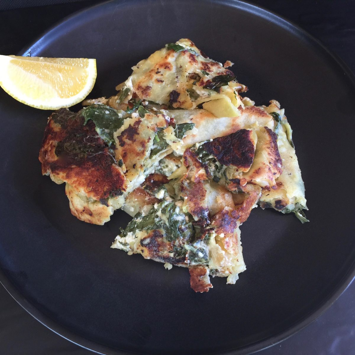 A pillow of cheesy spinach and feta mix containing mozzarella cheese, cumin, paprika, cayenne and black pepper in a tasty easy to make flat bread dressing with a tangy lemon juice by cooking meals for one