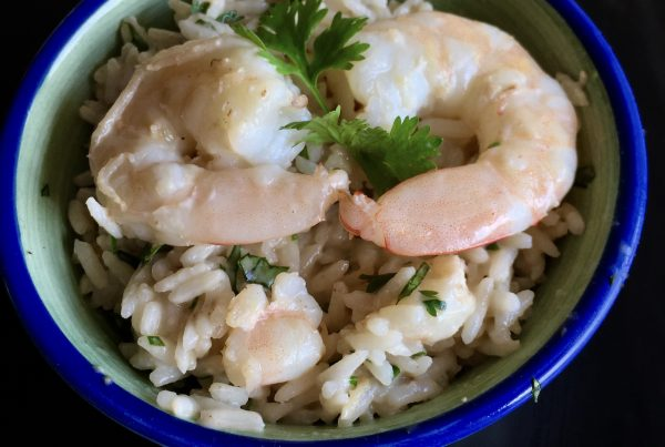 This Thai style full of flavour creamy coconut rice with a hint of kaffir lime leave and chopped coriander stir through not forgetting the pieces of prawn meat and 2 whole prawns placed on top with a sprig of coriander for garnish. Served in a royal blue rimmed bowl . Enjoy!
