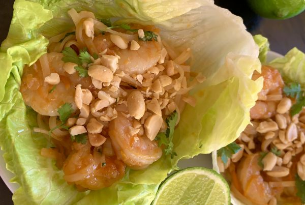 Prawn Pad Thai Lettuce Cups by cookongmealsforone.com a delicious combinations of prawns crisp carrots and green onions coriander and pad thai noodles dressing in a yummy pad thai paste nested in 2 crispy lettuce leaves sprinkles with chopped peanuts and squeeze of lime